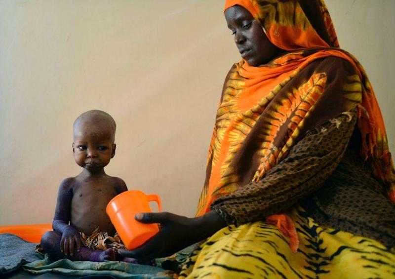 A child is fed a special formula by her mother at a hospital in Baidoa, Somalia, where drought is causing severe malnourishment: AFP/Getty