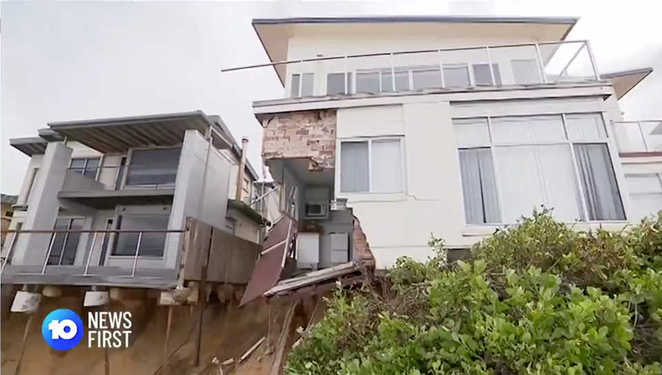 One of houses in Wamberal that has lost one of its walls. Source: 10 News First Sydney