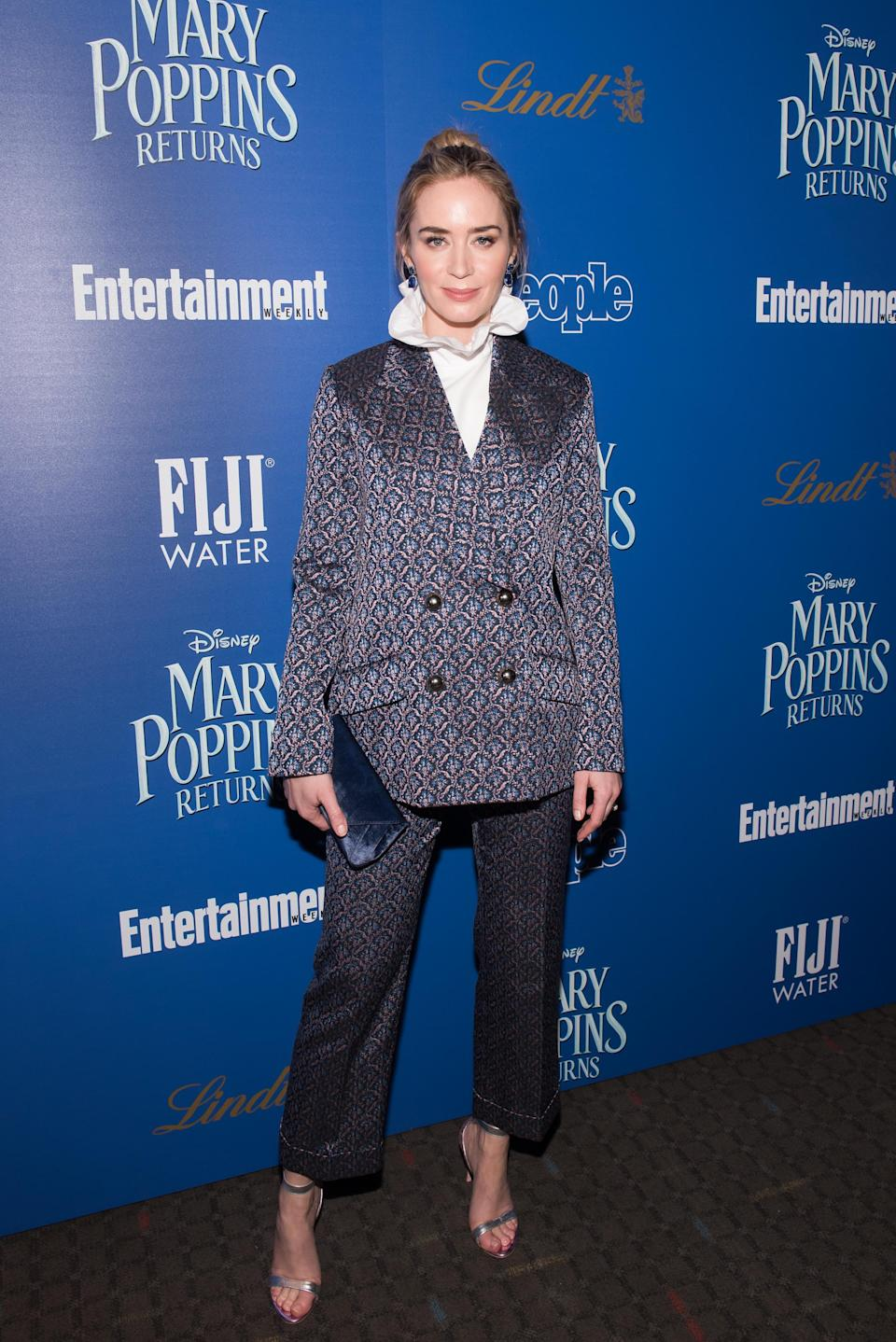 <p>The British star pulled another excellent outfit out of the bag at a 'Mary Poppins Returns' screening. Wearing Erdem, shoes by Sophia Webster and a bag by Tyler Ellis. <em>[Photo: Getty]</em> </p>