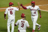 Los Angeles Angels' Justin Upton, right, celebrates his two-run home run with Anthony Rendon, left, and Taylor Ward during the fifth inning of the team's baseball game against the Arizona Diamondbacks on Tuesday, Sept. 15, 2020, in Anaheim, Calif. (AP Photo/Ashley Landis)