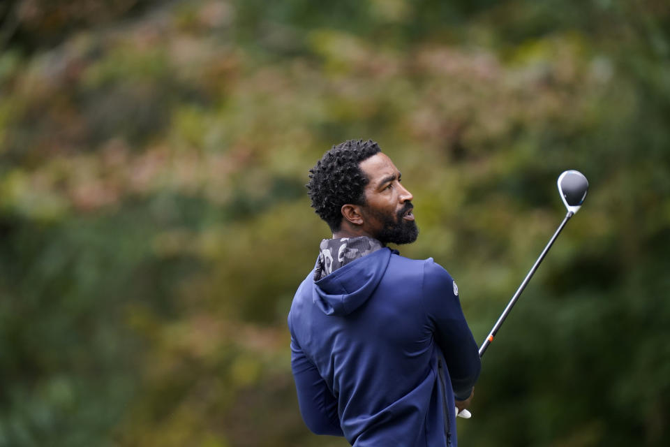 North Carolina A&T's J.R. Smith watches a tee shot on the 18th hole during the first round of the Phoenix Invitational golf tournament in Burlington, N.C., Monday, Oct. 11, 2021. Smith, who spent 16 years in the NBA made his college golfing debut in the tournament hosted by Elon. (AP Photo/Gerry Broome)