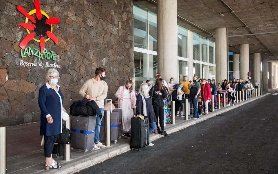 Several tourists wait in a queue to take a taxi outside Cesar Manrique international airport, in the island of Lanzarote, Canary Islands, Spain -  JAVIER FUENTES/EPA-EFE/Shutterstock