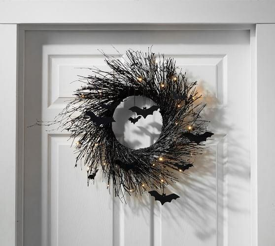 """<p>Add an easy <a class=""""link rapid-noclick-resp"""" href=""""https://www.popsugar.com/Halloween"""" rel=""""nofollow noopener"""" target=""""_blank"""" data-ylk=""""slk:Halloween"""">Halloween</a> touch to your front door with this <span>Pre-Lit Black Glitter Branch Wreath With Bats</span> ($59).</p>"""