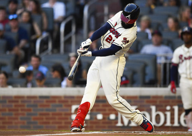 Atlanta Braves' Nick Markakis hits a two-run line drive single to right field during the first inning of a baseball game against the Washington Nationals, Sunday, July 21, 2019, in Atlanta. (AP Photo/John Amis)