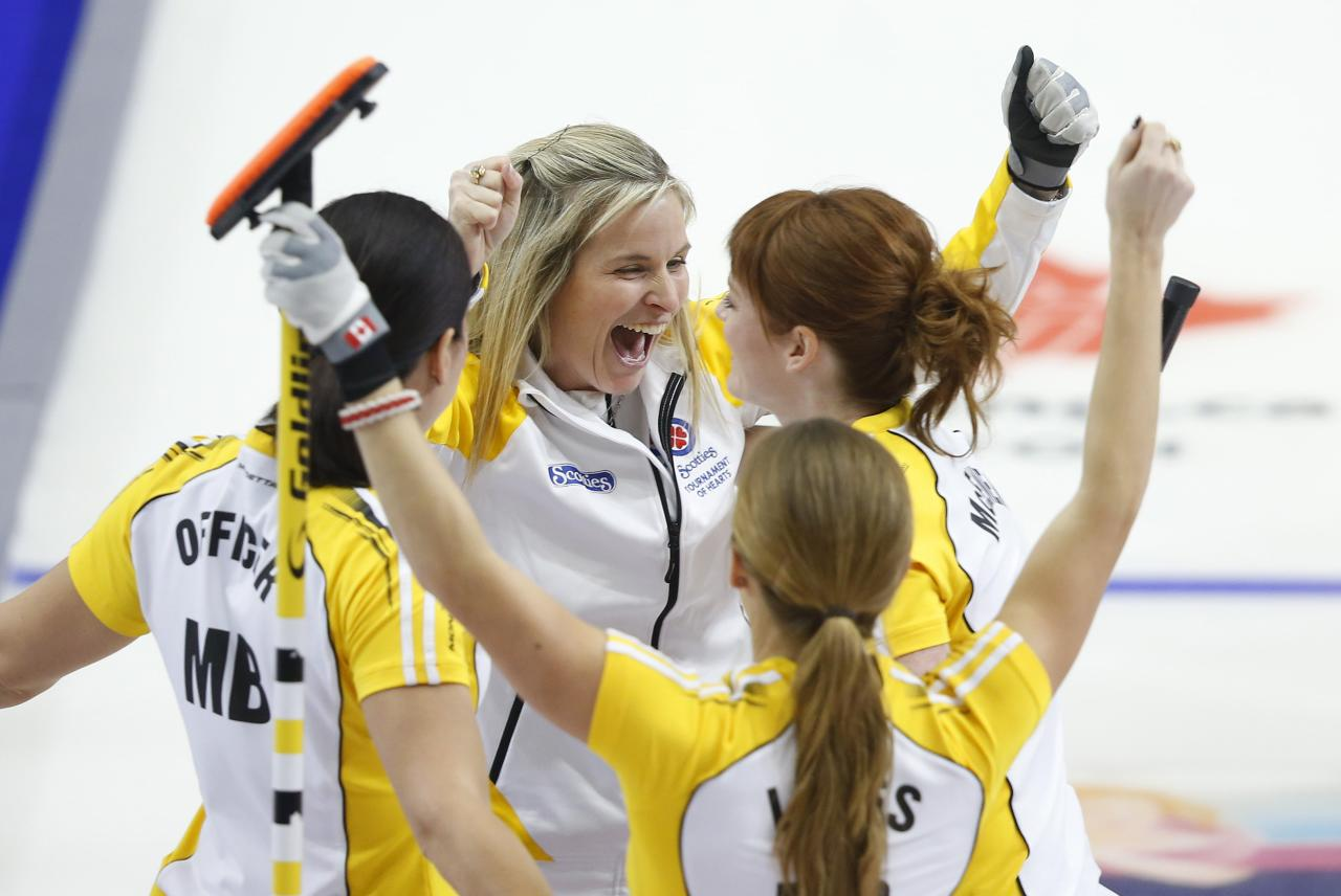 Manitoba's Jones celebrates with Officer, McEwen and Lawes after they defeated Alberta in the gold medal game during the Scotties Tournament of Hearts in Moose Jaw.
