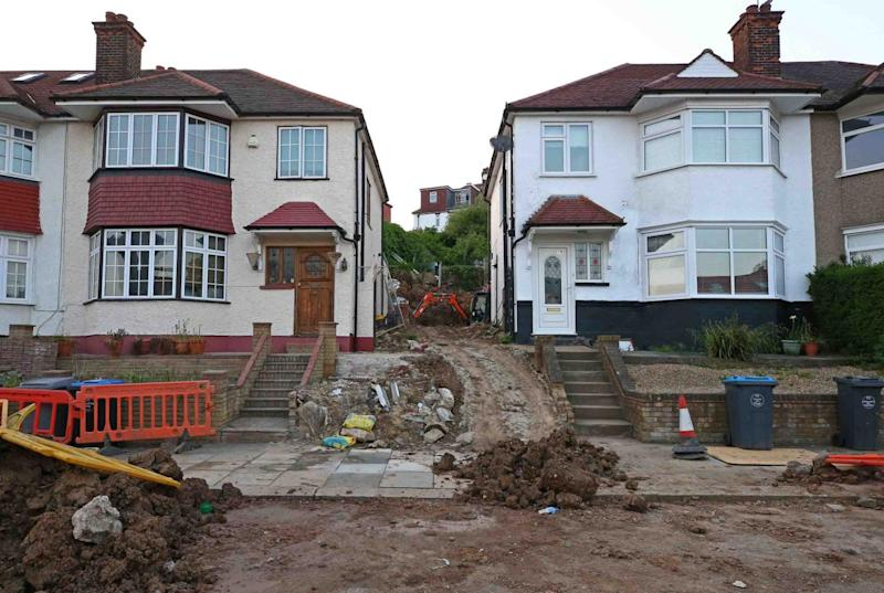 The woman in her 30s was moving earth on a sloping garden at her new home (Nigel Howard)