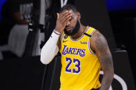 Los Angeles Lakers' LeBron James wipes his face after being fouled during the second half of an NBA conference final playoff basketball game against the Denver Nuggets Thursday, Sept. 24, 2020, in Lake Buena Vista, Fla. The Lakers won 114-108. (AP Photo/Mark J. Terrill)