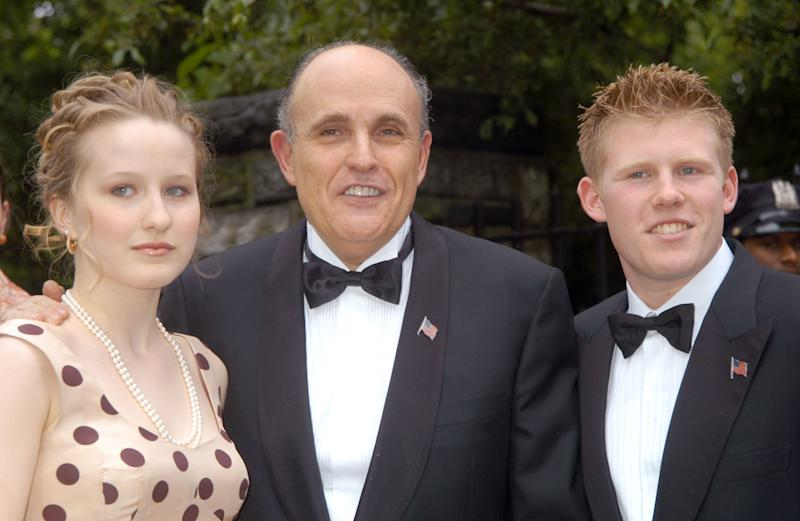 "Caroline Rose Giuliani with her father, Rudy Giuliani, and brother, Andrew at the 2003 wedding of Rudy and Judi Nathan. In a Vanity Fair essay published this week, Caroline wrote of her father, ""We are multiverses apart, politically and otherwise."" (Photo: Carmen Valdes/Ron Galella Collection via Getty Images)"