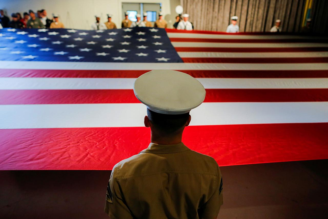 <p>Army members hold the U.S. flag as they attend the Museum's annual Memorial Day commemoration ceremony to honor the men and women who made the ultimate sacrifice while serving in the United States Armed Forces, at the Intrepid museum in New York, U.S., May 29, 2017. (Photo: Eduardo Munoz/Reuters) </p>