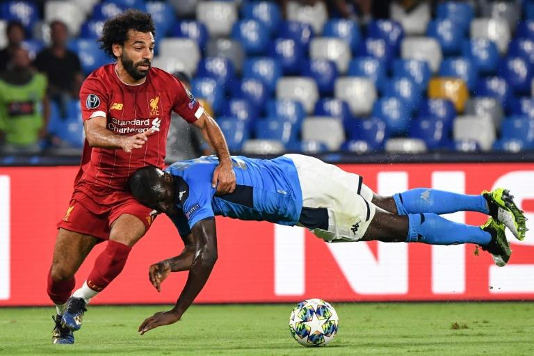 Napoli's defender Kalidou Koulibaly (R) blocked Liverpool's Egyptian midfielder star Mohamed Salah at the San Paolo stadium