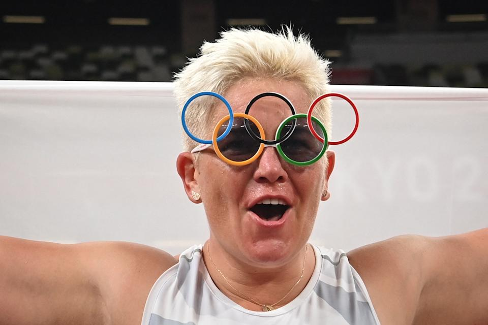 <p>Gold medallist Poland's Anita Wlodarczyk celebrates after the women's hammer throw final during the Tokyo 2020 Olympic Games at the Olympic Stadium in Tokyo on August 3, 2021. (Photo by Andrej ISAKOVIC / AFP) (Photo by ANDREJ ISAKOVIC/AFP via Getty Images)</p>