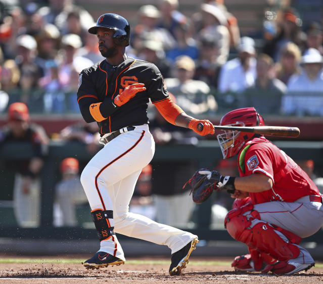 San Francisco Giants' Andrew McCutchen swings during a spring training baseball game against the Los Angeles Angels, Thursday, March 1, 2018, in Scottsdale, Ariz. (AP Photo/Ben Margot)
