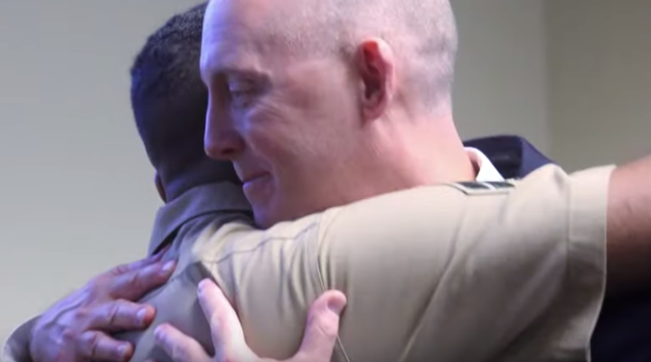 An FBI special agent reunited with a newborn he rescued over two decades ago at his retirement ceremony (Credit: YouTube)