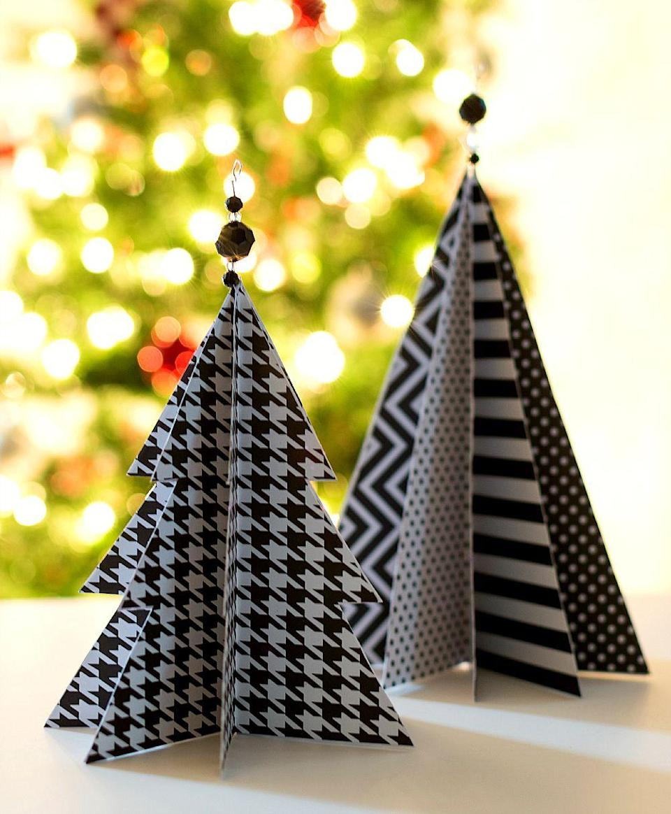 "<p>Render traditional Christmas trees in an unusual palette with this black-and-white patterned paper project. Accent your craft with crystal beads for added pizzazz.</p><p><em><a href=""https://www.itallstartedwithpaint.com/christmas-craft-idea-paper-trees/"" rel=""nofollow noopener"" target=""_blank"" data-ylk=""slk:Get the tutorial at It All Started With Paint»"" class=""link rapid-noclick-resp"">Get the tutorial at It All Started With Paint»</a></em></p>"