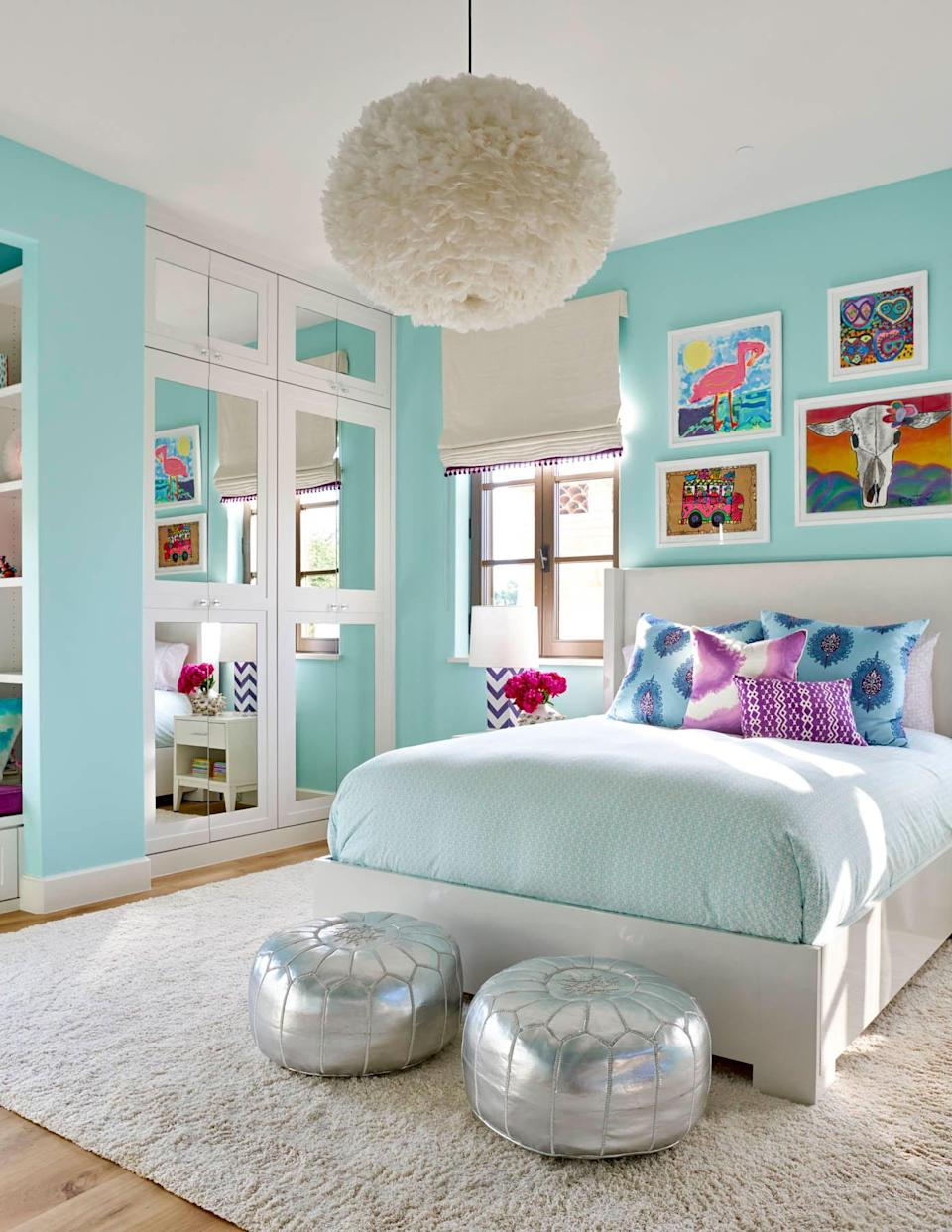 """<p>Morgan Farrow, Principal Designer of <a href=""""http://www.morganfarrow.com"""" rel=""""nofollow noopener"""" target=""""_blank"""" data-ylk=""""slk:Morgan Farrow Interiors"""" class=""""link rapid-noclick-resp"""">Morgan Farrow Interiors</a> in Dallas, says <a href=""""https://www.sherwin-williams.com/homeowners/color/find-and-explore-colors/paint-colors-by-family/SW6484-meander-blue"""" rel=""""nofollow noopener"""" target=""""_blank"""" data-ylk=""""slk:Meander Blue"""" class=""""link rapid-noclick-resp"""">Meander Blue</a> by Sherwin Williams works wonders for children's rooms. """"This aqua tone was the perfect paint selection for this girl's room and really added an extra layer of excitement and personality,"""" she says. """" When designing a small space, I think color selection can completely transform the overall feel. This bedroom now feels larger and provides a joyful place to grow.""""</p>"""