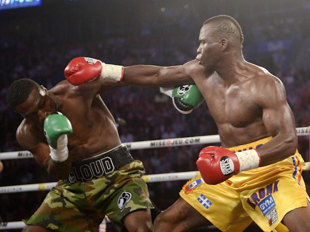 Adonis Stevenson, right, from Montreal, right, jabs Tavoris Cloud, of the United States, during their boxing bout Saturday, Sept. 28, 2013, in Montreal. (AP Photo/The Canadian Press, Ryan Remiorz)