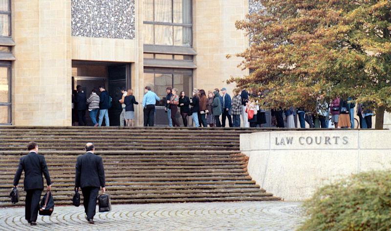 Prosecuting team (foreground) arrive as the queue of people move to the public gallery to hear Rosemary West give evidence in the trial at Winchester Crown Court. (Photo by Barry Batchelor - PA Images/PA Images via Getty Images)