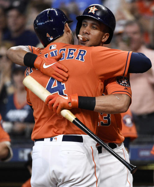 Houston Astros' George Springer, left, hugs Michael Brantley after hitting a solo home run off Los Angeles Angels starting pitcher Jose Rodriguez during the first inning of a baseball game, Sunday, Sept. 22, 2019, in Houston. (AP Photo/Eric Christian Smith)