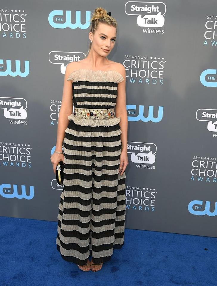 <p>Margot Robbie chose a ruffled Chanel dress for the occasion and finished the aesthetic with a chic, twisted topknot. <em>[Photo: Getty]</em> </p>