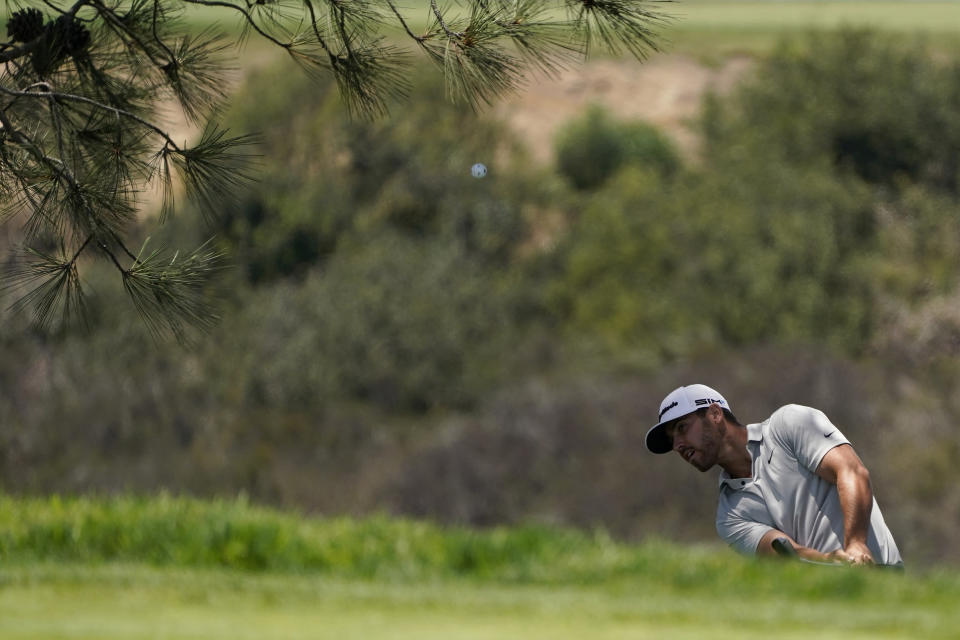 Matthew Wolff chips onto the seventh green during the first round of the U.S. Open Golf Championship, Thursday, June 17, 2021, at Torrey Pines Golf Course in San Diego. (AP Photo/Gregory Bull)