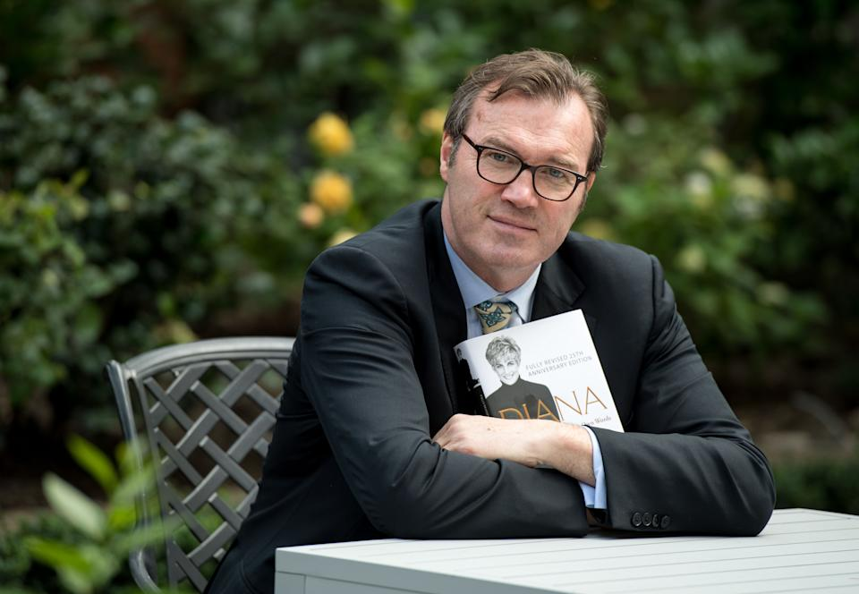 Author Andrew Morton poses with a copy of his book,