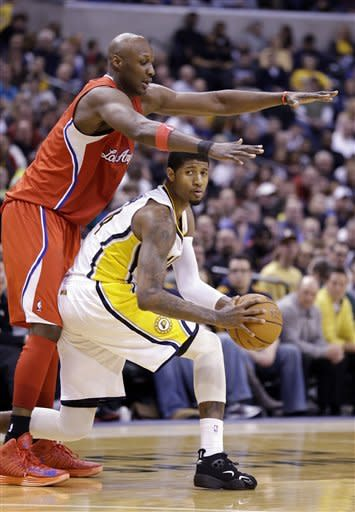 Los Angeles Clippers forward Lamar Odom, left, defends Indiana Pacers forward Paul George during the second half of an NBA basketball game in Indianapolis, Thursday, Feb. 28, 2013. The Clippers defeated the Pacers 99-91. (AP Photo/Michael Conroy)