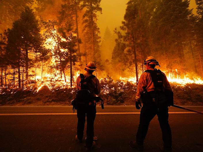 """Firefighters keep an eye on the Creek Fire along state Highway 168, September 6, 2020, in Shaver Lake, California. <p class=""""copyright""""><a href=""""https://newsroom.ap.org/detail/CaliforniaWildfires/18fc201319634de9b82eb2b6148e2186/photo?Query=creek%20AND%20fire&mediaType=photo&sortBy=arrivaldatetime:desc&dateRange=Anytime&totalCount=718&currentItemNo=11"""" rel=""""nofollow noopener"""" target=""""_blank"""" data-ylk=""""slk:Marcio Jose Sanchez/AP Photo"""" class=""""link rapid-noclick-resp"""">Marcio Jose Sanchez/AP Photo</a></p>"""