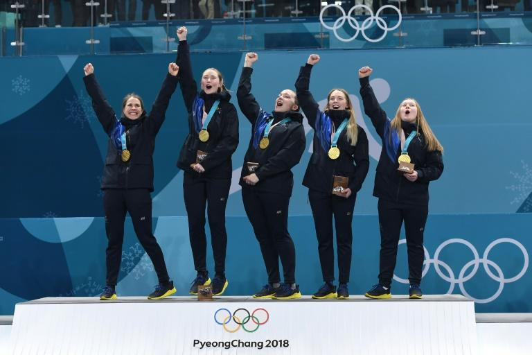 Sweden celebrate beating South Korea to win the women's curling gold medal at the Pyeongchang 2018 Winter Olympics