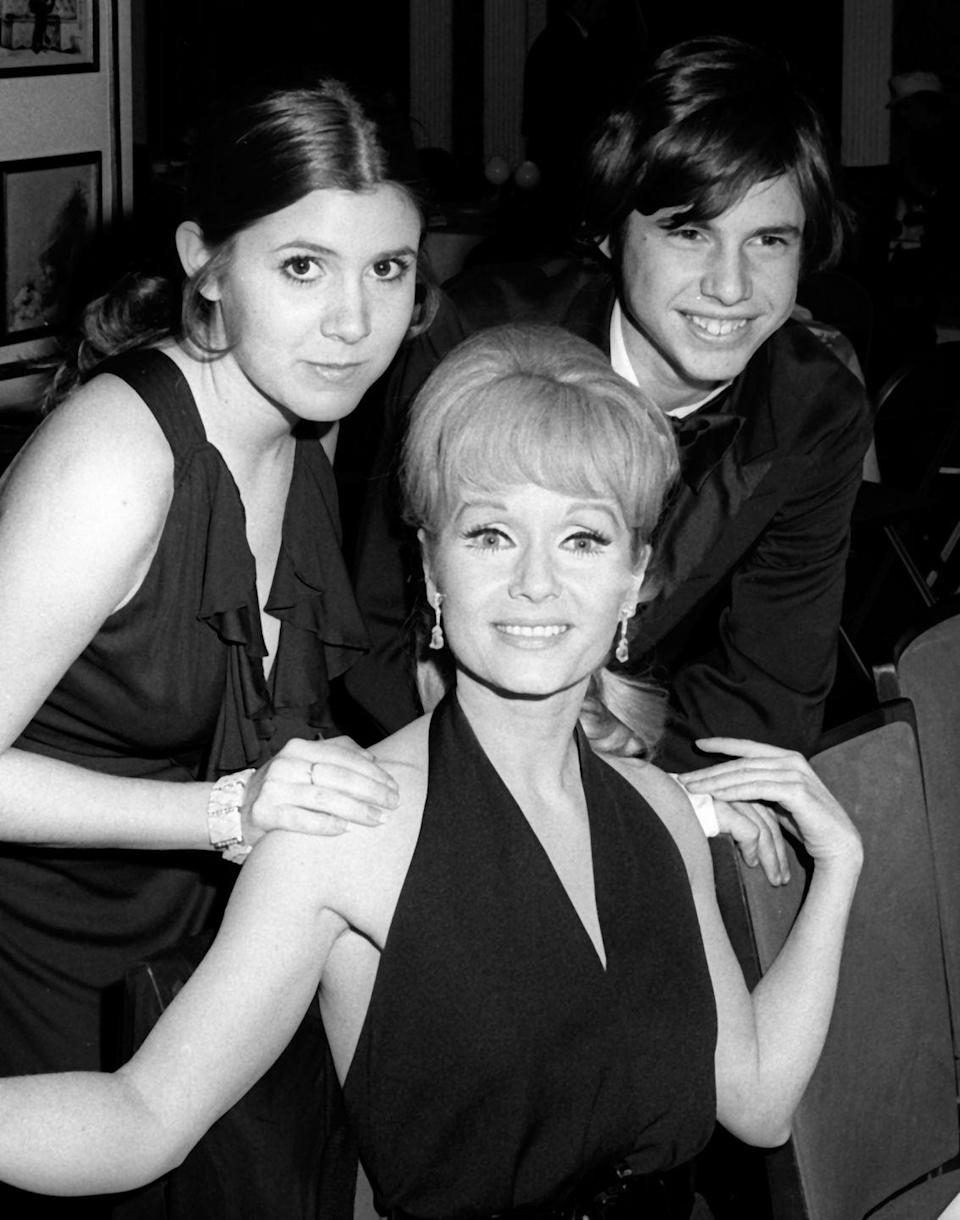 "<p>When Carrie's mother, Debbie, signed on to the <a href=""https://carriefisher.com/about/"" rel=""nofollow noopener"" target=""_blank"" data-ylk=""slk:Broadway play"" class=""link rapid-noclick-resp"">Broadway play </a><em><a href=""https://carriefisher.com/about/"" rel=""nofollow noopener"" target=""_blank"" data-ylk=""slk:Irene"" class=""link rapid-noclick-resp"">Irene</a></em>, the 15-year-old decided to attach herself to the project as well. In her debut performance, the young actress played a debutante in the show.</p>"
