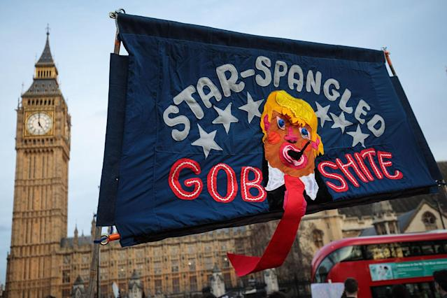 <p>A banner depicting U.S. President Donald Trump is held up during a rally in Parliament Square against his state visit to the U.K. on Feb. 20, 2017 in London, England. (Photo: Jack Taylor/Getty Images) </p>
