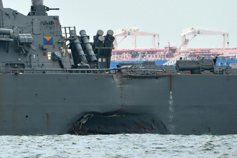 The USS John S. McCain with a hole on its  port side