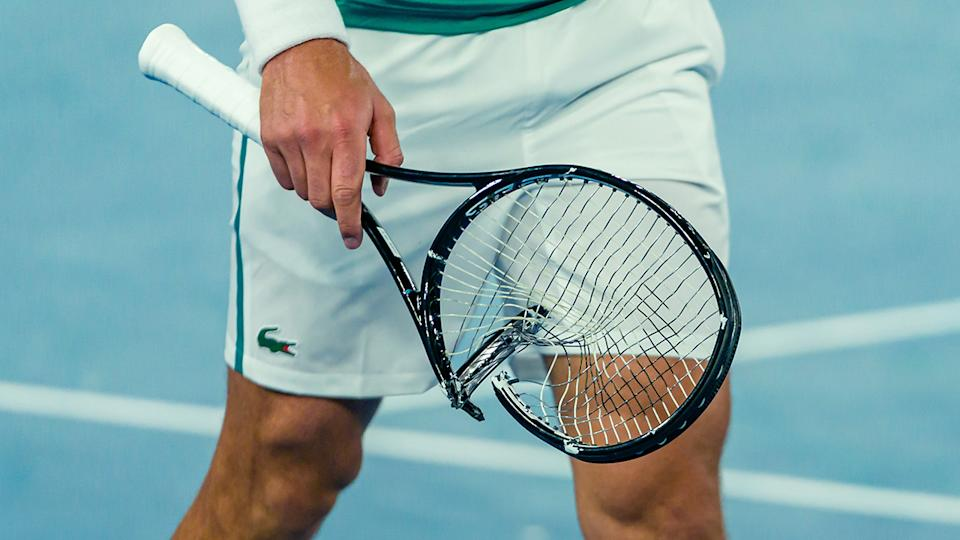 Novak Djokovic, pictured here holding his smashed racquet during his match against Alexander Zverev.