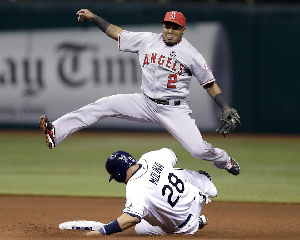 Los Angeles Angels shortstop Erick Aybar leaps over Tampa Bay Rays' Jose Molina (28) after forcing him at second base on a fourth-inning fielder's choice by Rays' Sam Fuld during a baseball game Tuesday, Aug. 27, 2013, in St. Petersburg, Fla. (AP Photo/Chris O'Meara)