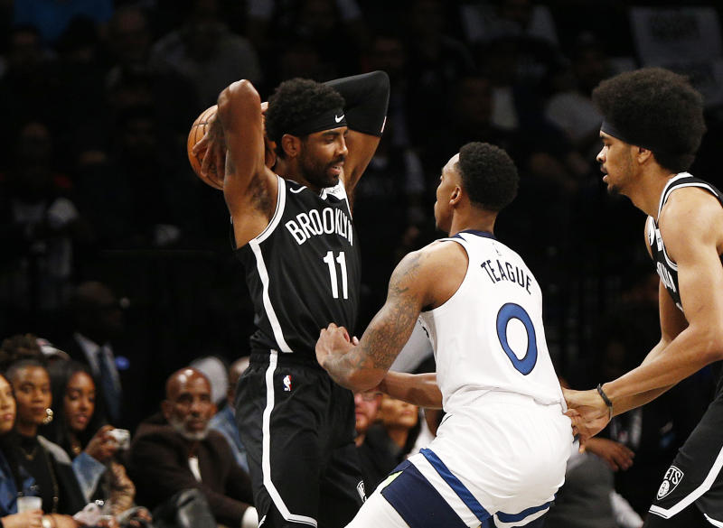 Kyrie Irving had a record-setting night in his Nets debut, but came up just short of the win column against the Timberwolves. (Andy Marlin/Reuters)