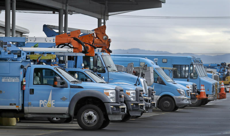Pacific Gas & Electric vehicles are parked at the PG&E Oakland Service Center, Monday, Jan. 14, 2019, in Oakland, Calif. Facing potentially colossal liabilities over deadly California wildfires, PG&E will file for bankruptcy protection. The announcement today follows the resignation of the power company's chief executive. (AP Photo/Ben Margot)