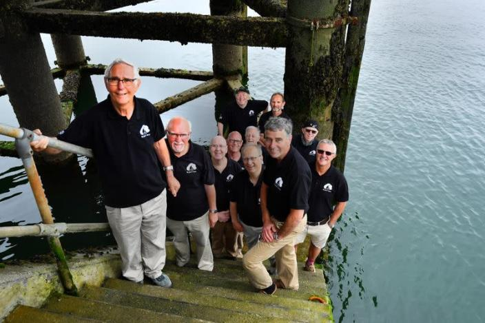 Sea Shanty singing group Bryher's Boys pose for a picture at Prince Wales Pier in Falmouth
