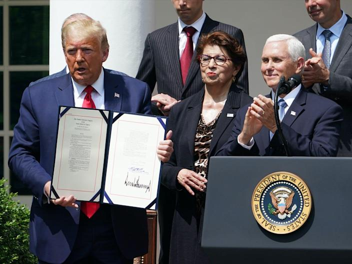 President Trump showing the signed bill authorizing an extension to the Paycheck Protection Program application deadline.