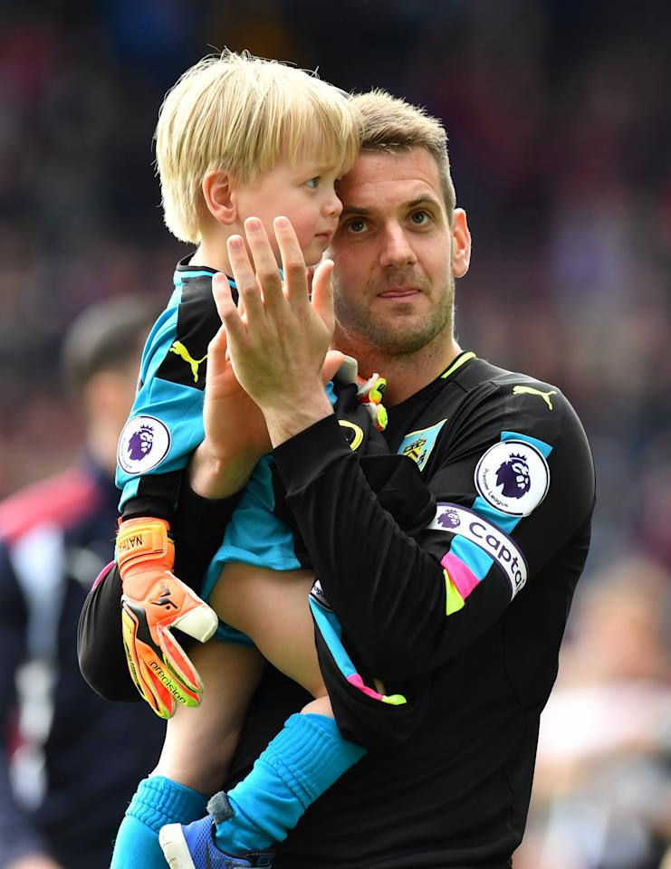 """Britain Football Soccer - Burnley v West Ham United - Premier League - Turf Moor - 21/5/17 Burnley's Tom Heaton applauds fans after the match  Reuters / Anthony Devlin Livepic EDITORIAL USE ONLY. No use with unauthorized audio, video, data, fixture lists, club/league logos or """"live"""" services. Online in-match use limited to 45 images, no video emulation. No use in betting, games or single club/league/player publications.  Please contact your account representative for further details."""