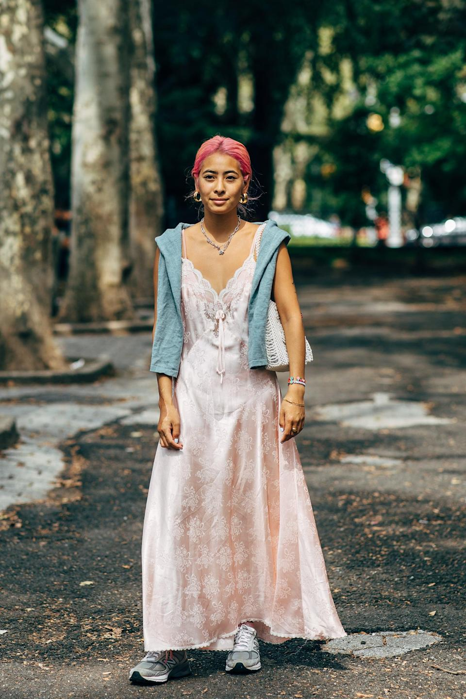 <p>Finish a romantic slip dress with cool sneakers. </p>