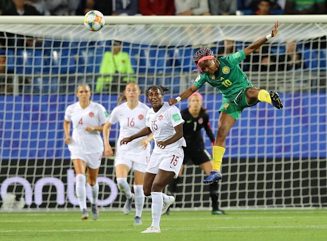 MONTPELLIER, FRANCE - JUNE 10: Jeannette Yango of Cameroon wins a header during the 2019 FIFA Women's World Cup France group E match between Canada and Cameroon at Stade de la Mosson on June 10, 2019 in Montpellier, France. (Photo by Elsa/Getty Images)
