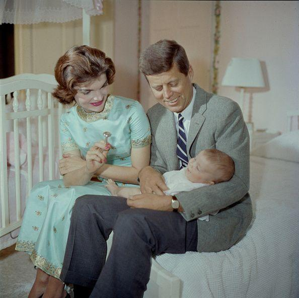 <p>Senator John F. Kennedy and his wife Jacqueline hold their four-month-old daughter Caroline. </p>