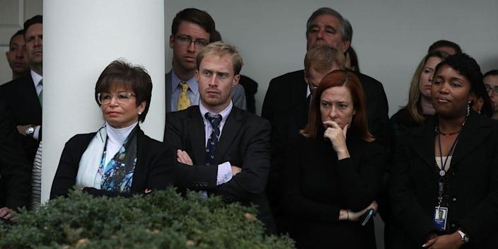 White House staff, including Press Secretary Josh Earnest (2nd L), senior advisor Valerie Jarrett (3rd L) and Communication Director Jen Psaki (2nd R), listen as U.S. President Barack Obama makes a statement on the election results at the Rose Garden of the White House November 9, 2016.