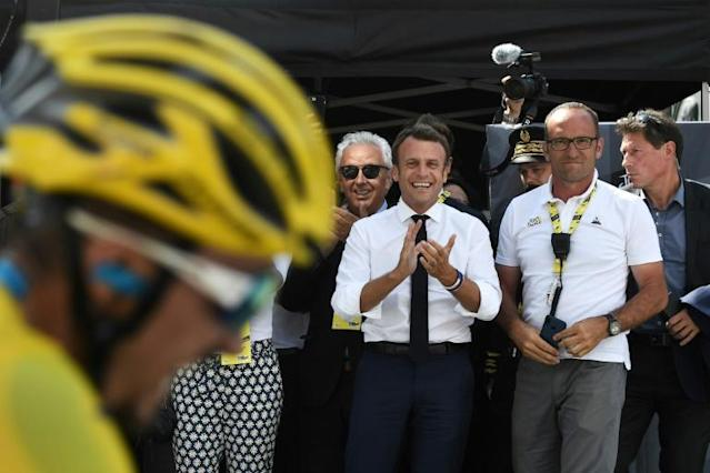 French President Emmanuel Macron greeting Alaphilippe in the Pyrenees on Saturday (AFP Photo/JEFF PACHOUD)