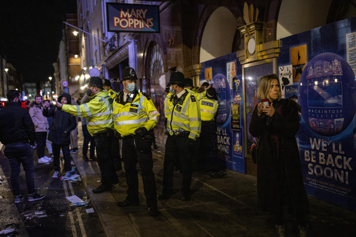 LONDON, ENGLAND - APRIL 16: Police officers arrest a man on Old Compton Street in Soho on April 16, 2021 in London, England. Pubs and Restaurants are expecting good business tonight being the first Friday night after Coronavirus lockdown rules were relaxed to allow outside dining and drinking. (Photo by Rob Pinney/Getty Images)