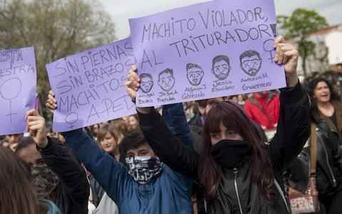 People shout slogans and hold banners during a demonstration against the verdict of the 'Wolf Pack' gang rape case in 2018 - Credit: Gari Garaialde/Getty Images