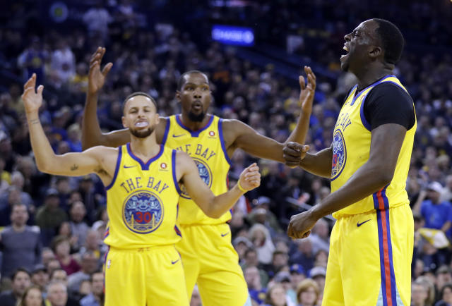 Golden State Warriors' Draymond Green, right, reacts as a foul is called against him next to teammates Stephen Curry, left, and Kevin Durant during the first half of an NBA basketball game against the Oklahoma City Thunder Saturday, Feb. 24, 2018, in Oakland, Calif. (AP Photo/Marcio Jose Sanchez)