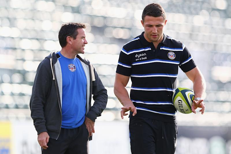 Sam Burgess (R) the new signing for Bath Rugby in conversation with Head Coach Mike Ford (L) in 2014.