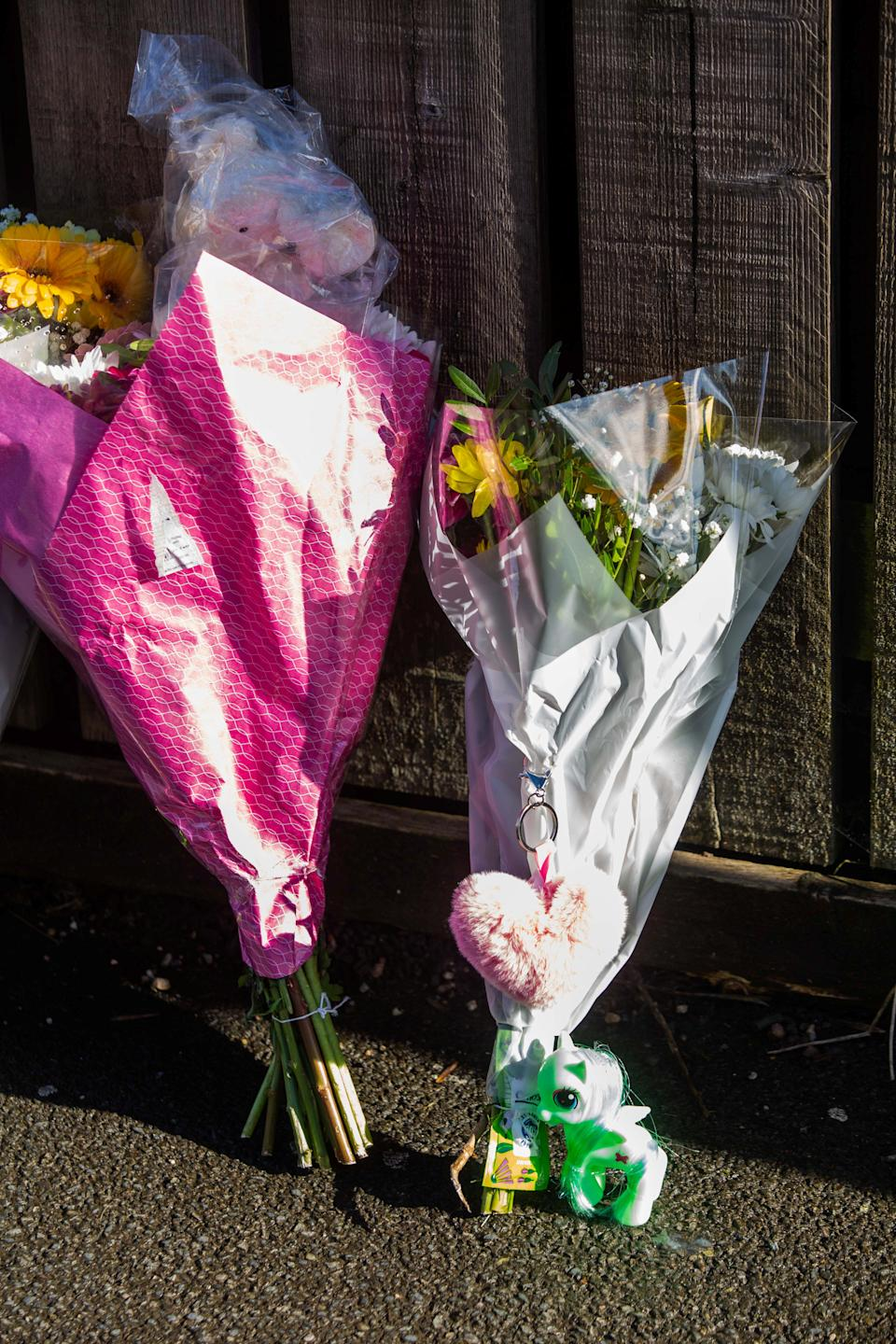 Floral tributes have been left by Clayton Road. (SWNS)
