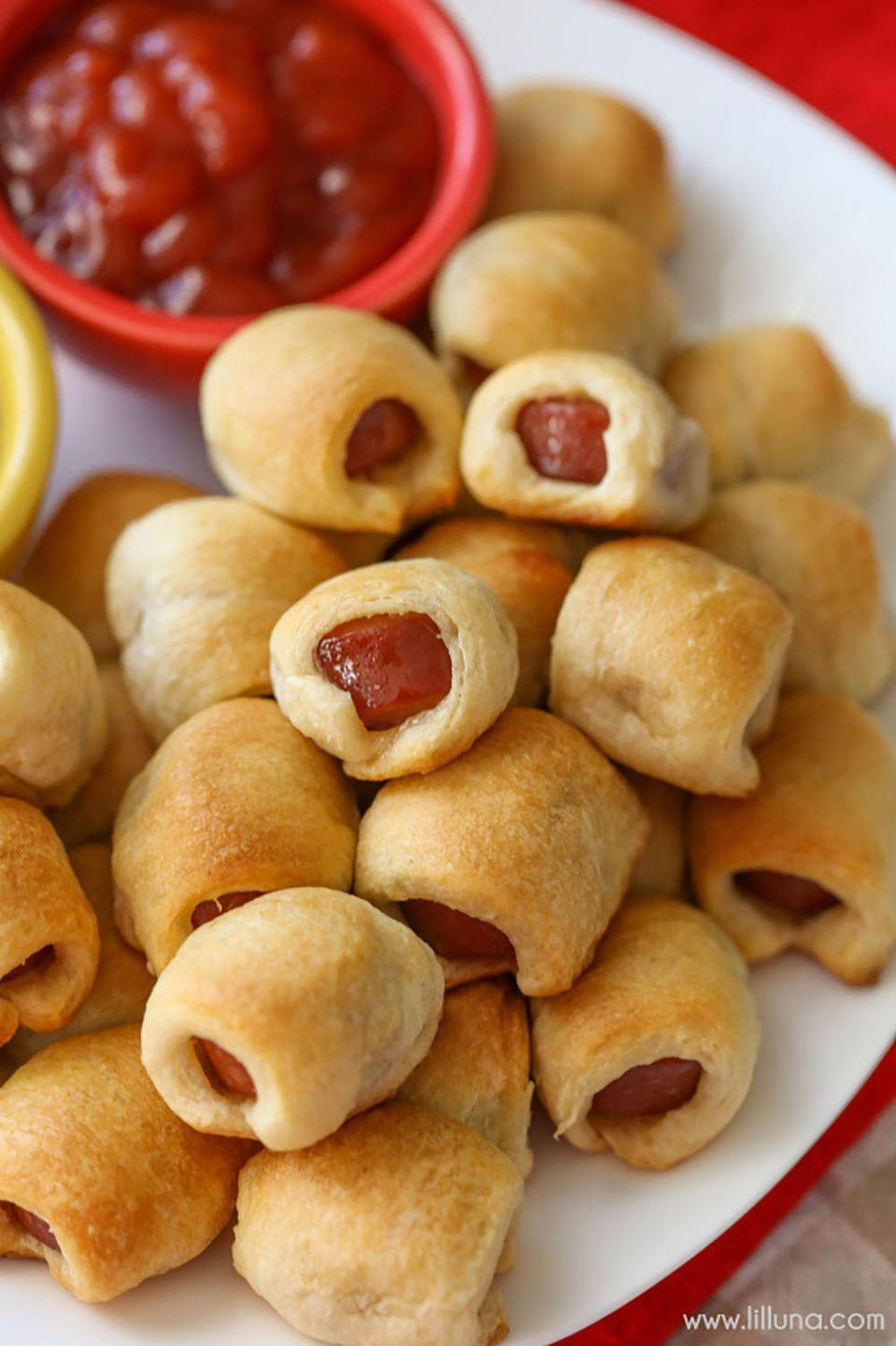 """<p>Hot dogs become 10 times more fun when they're bite-size. Plus, they're perfect for dipping in marinara!</p><p><strong>Get the recipe at <a href=""""https://lilluna.com/corn-dog-nuggets/"""" rel=""""nofollow noopener"""" target=""""_blank"""" data-ylk=""""slk:Lil' Luna"""" class=""""link rapid-noclick-resp"""">Lil' Luna</a>. </strong><br></p>"""