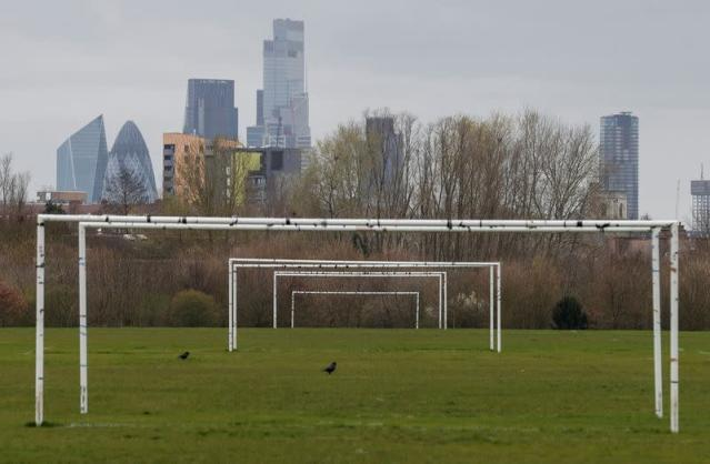 Empty pitches are seen on Hackney Marshes in London